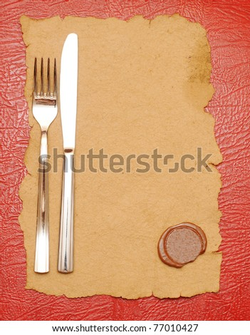 knife and fork on old paper. space for the text - stock photo
