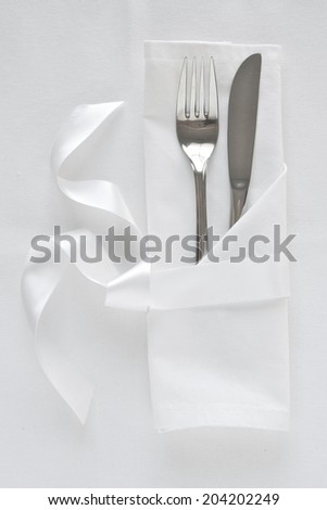 Knife and fork table setting with white linen and satin ribbon & Table Place Setting White Stock Photo (Royalty Free) 58790044 ...