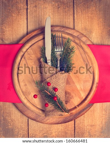 Knife and fork utensils in Christmas table setting - stock photo