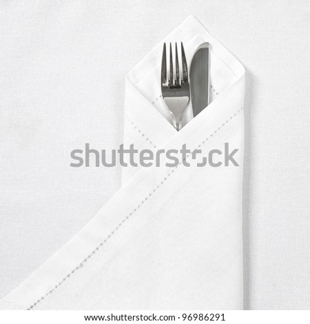 Knife and fork with linen serviette - stock photo