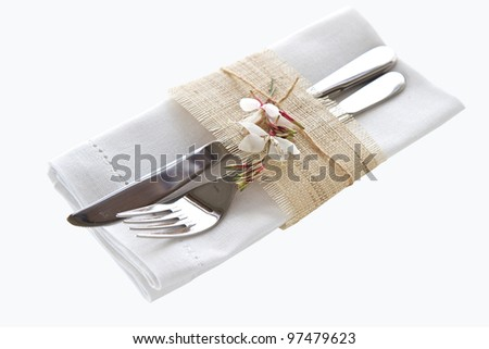 Knife and fork with napkin isolated on white background - stock photo
