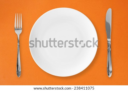 knife and fork with plate  - stock photo