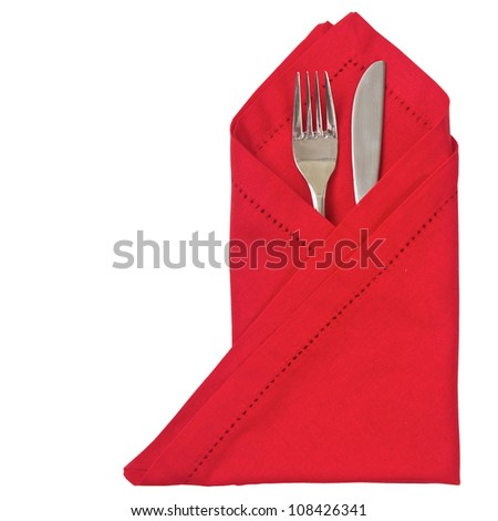 Knife and fork with red napkin for Christmas and isolated - stock photo