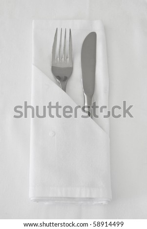 Knife and Fork with white linen - stock photo