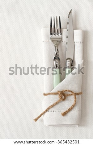 Knife and Fork with white linen and space for text