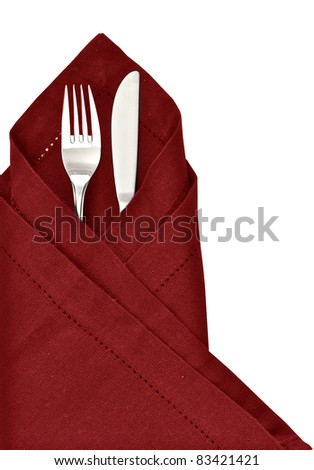 Knife and fork wrapped in red napkin as a table setting isolated on a white background - stock photo