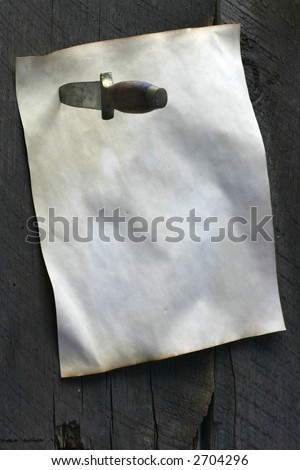 Knife attaching parchment to wall view from above more wall showing - stock photo