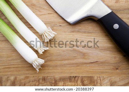 Knife, Chives and a Cutting Board - stock photo