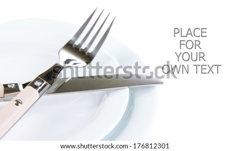 Knife, color plate and fork, isolated on white  - stock photo