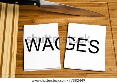 Knife cut paper with wages word