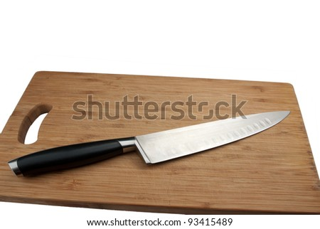 knife for meat and cutting board isolated on a white background