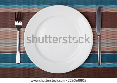 Knife, Fork and plate on table.