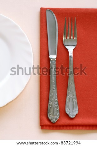 knife, fork and plate on table