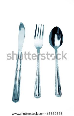 Knife, fork and spoon isolated on white