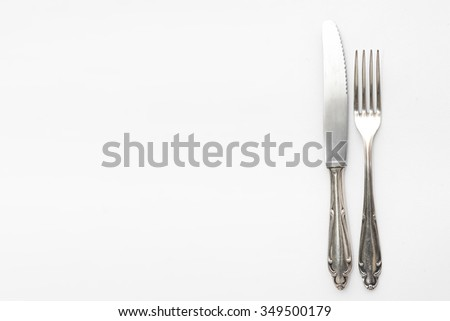 Knife, fork - beautiful old silver cutlery on white background, copy space - stock photo