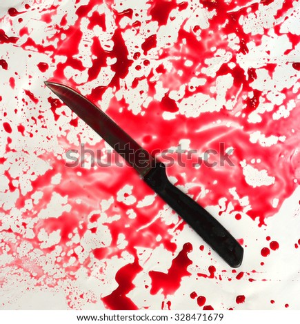knife on blood texture background