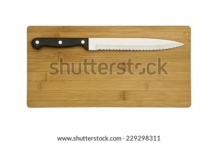 Knife on the chopping board - stock photo