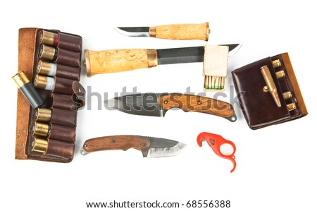 Knifes and ammunition for hunters over white.