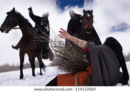 Knight asked for directions from the peasant - stock photo