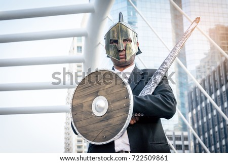 Knight businessman wearing an helm and steel sword.
