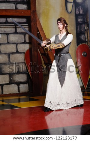 Knight girl with long blade - stock photo
