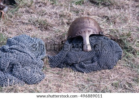 knight helmet  with mail armour on the grass