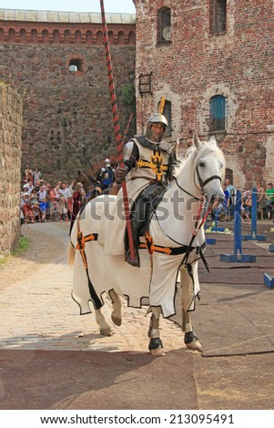 Knight. Knightly tournament in old castle in Vyborg (Russia) 26 july 2014. - stock photo