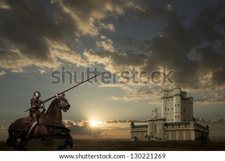 Knight on horseback, castle in background - stock photo