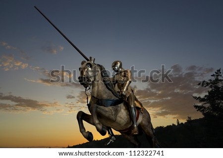 Knight on horseback, with armor and lance, against clouds