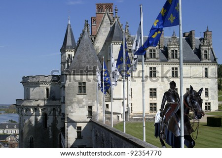 Knight riding in courtyard - stock photo