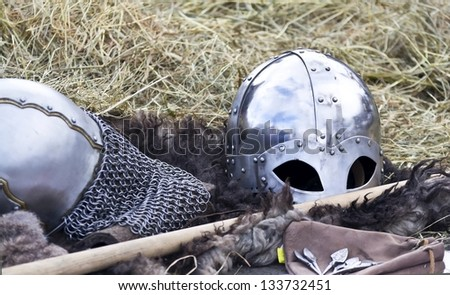 knight's helmet on a background of hay - stock photo