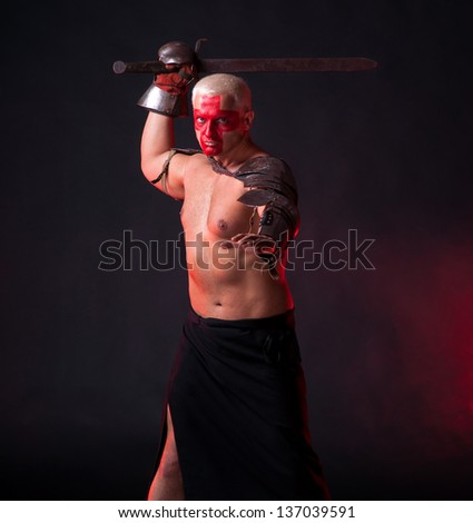 Knight with a sword on a dark red background