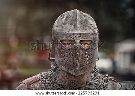 Knight with helmet - stock photo