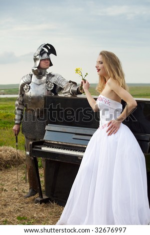 knightly romance / bride / piano - stock photo