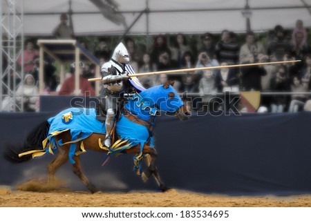 Knights tournament. Horseman with a spear - stock photo