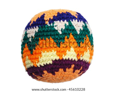 Knit multicolored hacky sack isolated on white - stock photo
