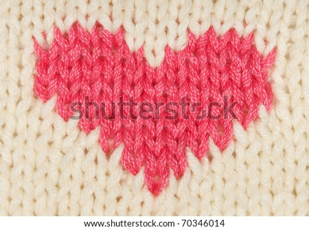 knit red heart of the warm woolen threads - stock photo