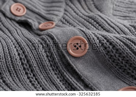 Knit sweater closeup button - stock photo