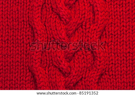 Knit woolen texture. Fabric red background - stock photo