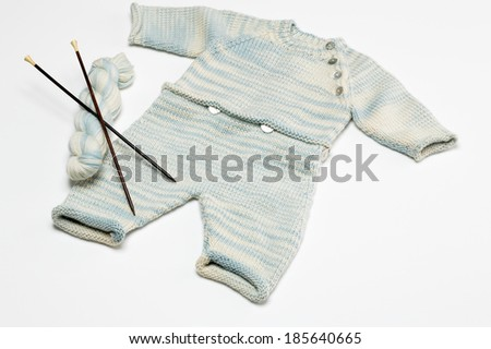 Knitted Baby Outfit - stock photo
