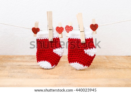 Knitted baby socks hanging on the clothesline - stock photo