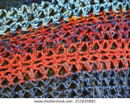 Knitted background on tree bark - stock photo