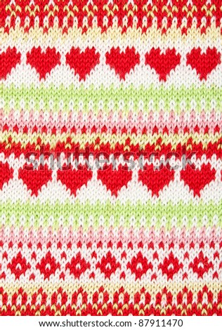 knitted background with a pattern in the shape of heart. - stock photo