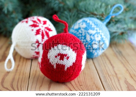 Knitted balls for New Year tree decoration with the sheep and snowflake patterns