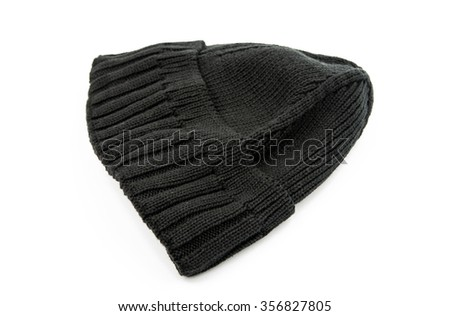 knitted cap on a white background - stock photo