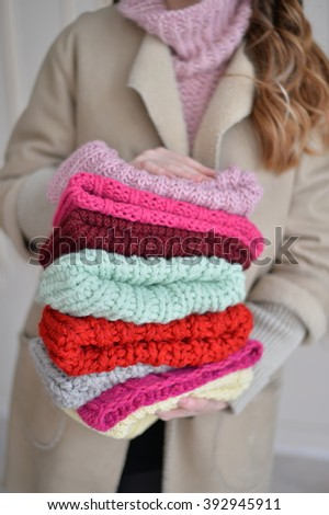 knitted caps in her hand - stock photo