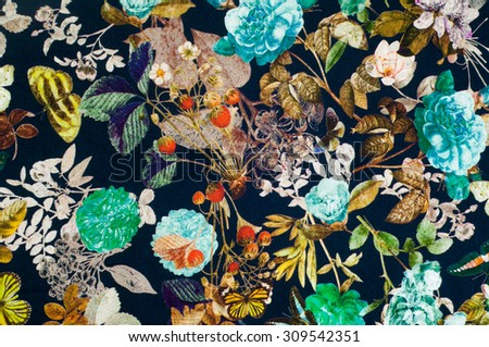 Knitted fabric. Flowers, berries and butterflies on a black background. texture. Photography Studio - stock photo