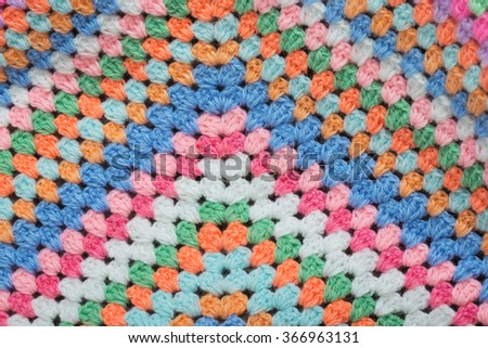 Knitted fabric hand-crocheted wool - stock photo