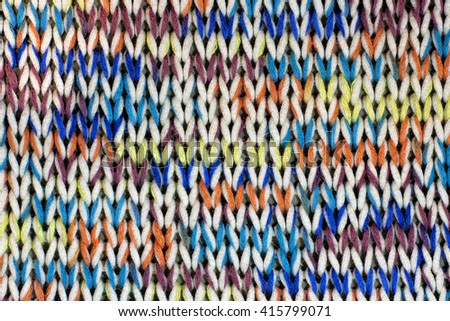 Knitted fabric of colored yarn. - stock photo