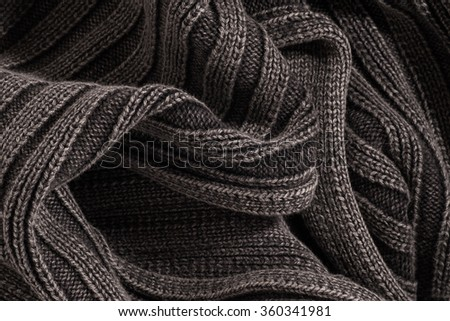 Knitted fabric wool, ribbed gray-black. Texture, background. - stock photo
